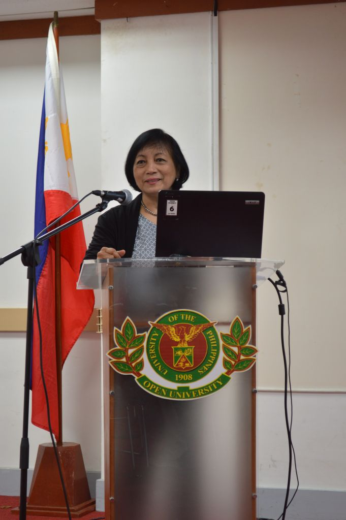 climate change consultant giving speech on roles of women and men in agriculture